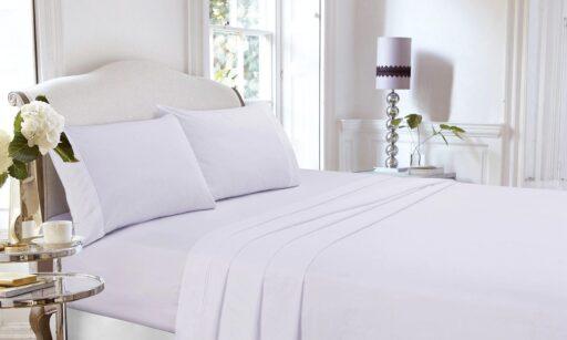 Cama lujosa con sábanas de percal de algodón 100%