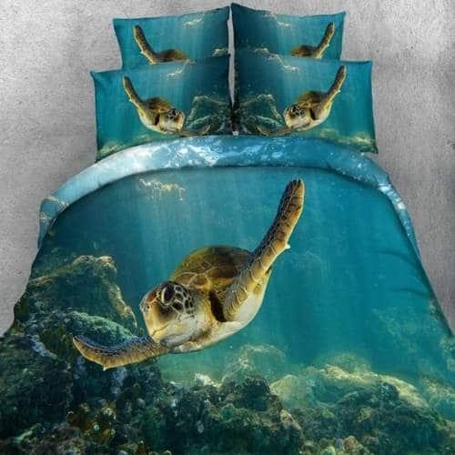 juego de funda nordica con tortugas nadando en fondo marino en colores azules y verdes